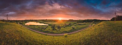 Panorama of majestic colorfull sunset over the river valley