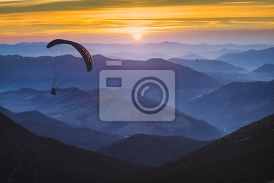 Paraglide and the sunrise