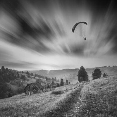 Paraglide in a sky. Monochrome picture