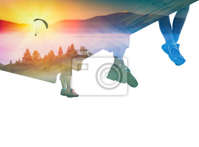 Paraglide silhouette in a sky and group of hikers