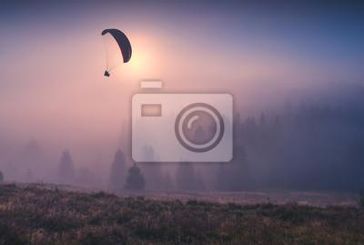 Paraglider flying and making selfie
