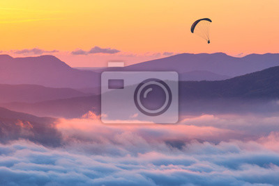 Paraglider over the sunset in a Crimea mountains
