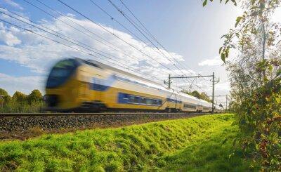 Sticker Passenger train moving at high speed in sunlight
