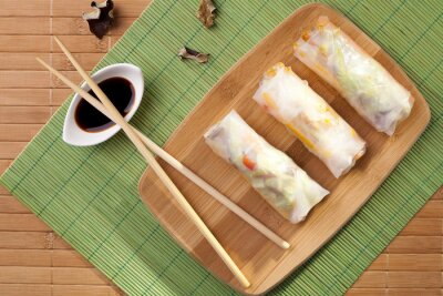 Sticker Portion of spring rolls on a bamboo board