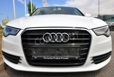 Sticker PRAGUE, THE CZECH REPUBLIC, 02.08.2015 - Brand new white Audi A6 parks in front of Car Store Audi