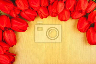 Red tulips on a wooden background_5