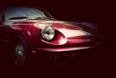 Sticker Retro classic car on dark background. Vintage, elegant