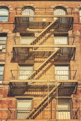Sticker Retro style photo of building with fire escape ladders, NYC.