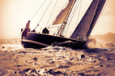 Sticker sail boat sailing on sunset