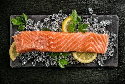 Sticker Salmon filet served on black stone