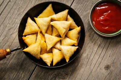 Sticker Samosas - Popular Indian deep fried snack with potato filling and covered with crispy crust