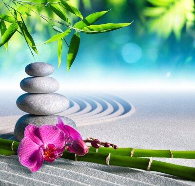 Sticker sand, orchid and massage stones in zen garden