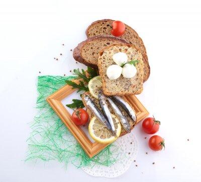 Sticker sardines on slice bread