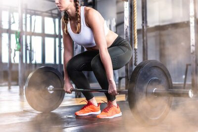 Sticker Shot of fitness woman in gym with barbell