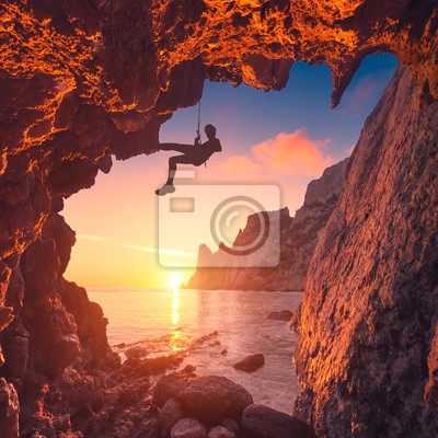 Silhouette of climber in a mountain cave