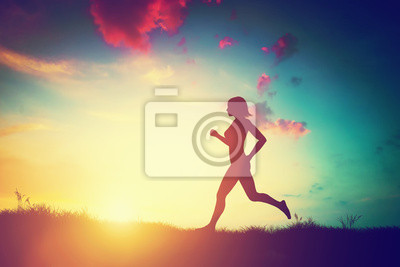 Sticker Silhouette of woman running at sunset