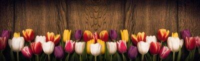 Sticker Spring tulips on wooden background