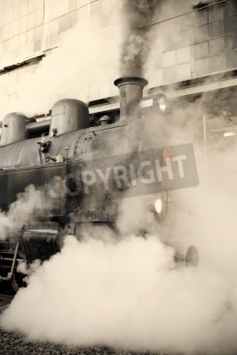 Sticker Steam locomotive at the railway station wrapped up in cloud - vintage retro tinting