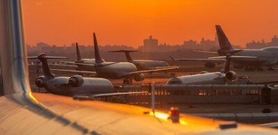 Sticker Sunset at the airport with airplanes ready to take off