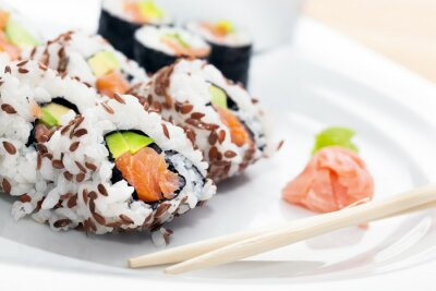 Sticker Sushi with salmon, avocado, rice in seaweed served with wasabi and ginger.