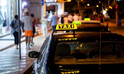 Sticker Taxi sign at night