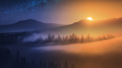 The rising sun and night starry sky