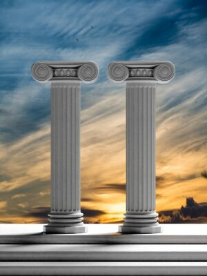 Sticker Two ancient pillars with sunset sky background.