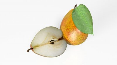 Sticker Two pears, one sliced in half, fruit isolated on white background