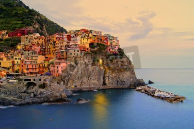 Sticker Village of Manarola, Italy on the Cinque Terre coast at sunset