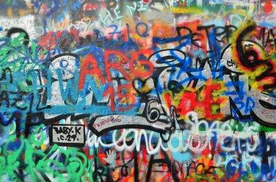 Sticker wall sprayed with graffiti