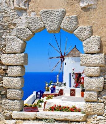 Sticker Windmill through an old window in Santorini island, Greece