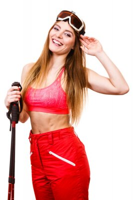 Sticker Woman skier in googles with ski poles. Winter sport