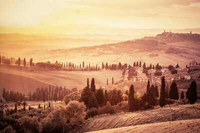 Sticker Wonderful Tuscany landscape with cypress trees, farms and small medieval towns, Italy. Vintage sunset