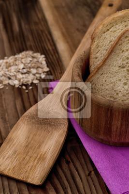 Sticker Домашний хлеб на фоне древесины.