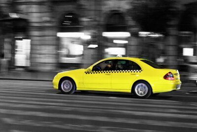 Sticker yellow taxi moves on the night city street