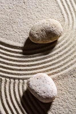 Sticker zen sand still-life - two stones set across sand lines for concept of spirituality or serenity, top view